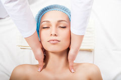 Attractive blonde getting relaxing massage of head Royalty Free Stock Photos