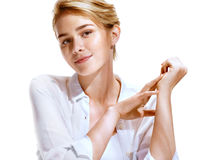 Attractive blonde girl with beautiful make up. On white background. Youth and skin care concept stock image