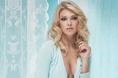 Attractive blonde girl in bedroom Stock Images