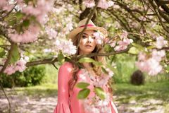 Attractive blonde girl in blooming garden. Royalty Free Stock Image