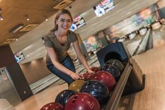 Girl playing bowling Stock Photography