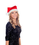 Attractive blonde girl with Christmas hat Royalty Free Stock Image