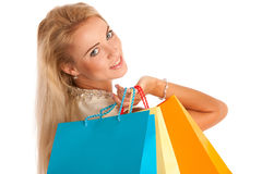Attractive blonde girl with colorful shopping bags Stock Image