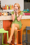 Attractive blonde girl drinking coffee Royalty Free Stock Images