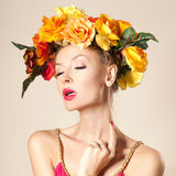 Attractive blonde girl with flowers Stock Images