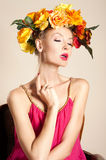 Attractive blonde girl with flowers Royalty Free Stock Image