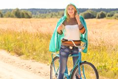 Attractive blonde girl during her cycling Stock Image
