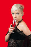 Attractive blonde girl holding glass of red wine Stock Images