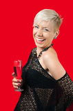 Attractive blonde girl holding glass of red wine. Attractive blonde with short hair in black web shirt holding glass of red wine laughing Royalty Free Stock Image