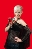 Attractive blonde girl holding glasses of red and white wine. Attractive blonde with short hair in black web shirt holding glasses of red and white wine smiling royalty free stock photography
