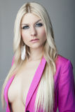 Attractive blonde girl in jacket Royalty Free Stock Photos