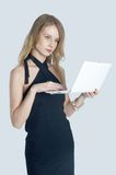 Attractive blonde girl with laptop Stock Images