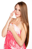 Attractive blonde girl puts cream on face Royalty Free Stock Images