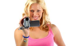 Attractive blonde girl recording with video camera Royalty Free Stock Images