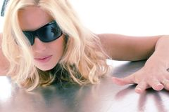 Attractive blonde girl with sunglasses Stock Image