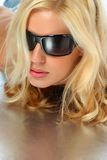 Attractive blonde girl with sunglasses Stock Photography