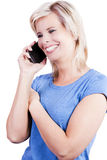 Attractive blonde girl using a smart phone. Royalty Free Stock Photos