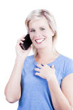 Attractive blonde girl using a smart phone. Royalty Free Stock Photo