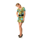 Attractive blonde in green summer dress Stock Image