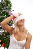 Attractive blonde with her christmas hat Royalty Free Stock Photos