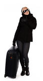 Attractive blonde holding her black luggage Stock Photography
