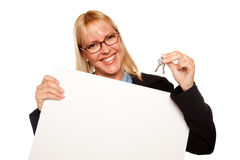 Attractive Blonde Holding Keys & Blank White Sign stock photos