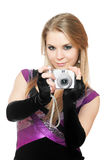 Attractive blonde holding a photo camera. Isolated Stock Photography