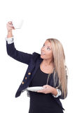 Attractive blonde holding teacup and saucer Stock Photography