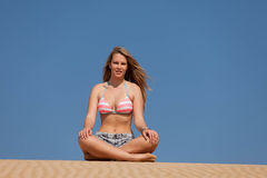 Attractive blonde lady on the beach Stock Images
