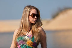Attractive blonde lady on the beach Royalty Free Stock Photos