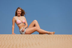 Attractive blonde lady on the beach Stock Photo