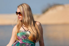Attractive blonde lady on the beach Stock Photography