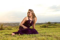Attractive blonde lady on hill over town Royalty Free Stock Image