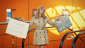 Attractive blonde lady posing with shopping bags Royalty Free Stock Photos