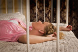 Attractive blonde lying on the bed Royalty Free Stock Photo