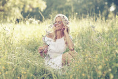 Attractive blonde lying in the field Royalty Free Stock Images