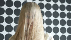 Attractive blonde model girl at the beauty salon stock footage