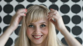 Attractive blonde model girl at the beauty salon stock video