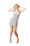 Attractive blonde in a nightie barefoot Stock Photography