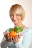 Attractive blonde with an orange Stock Image