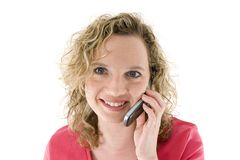 Attractive blonde with a phone. Attractive blonde with a mbile phone isolated on white Royalty Free Stock Photography