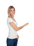 Attractive blonde pointing something with her finger Royalty Free Stock Images