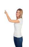 Attractive blonde pointing something with her finger Royalty Free Stock Photos