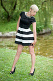 Attractive blonde posing near the lake Royalty Free Stock Image