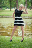 Attractive blonde posing near the lake Royalty Free Stock Photos