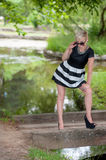 Attractive blonde posing near the lake Stock Photo