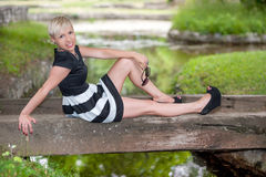 Attractive blonde posing near the lake Royalty Free Stock Images