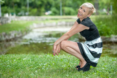 Attractive blonde posing near the lake Stock Images