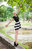 Attractive blonde posing near the lake Stock Image