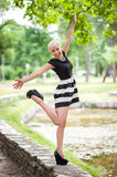 Attractive blonde posing near the lake Royalty Free Stock Photo